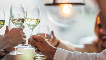 Photo of a wine toast at a dinner